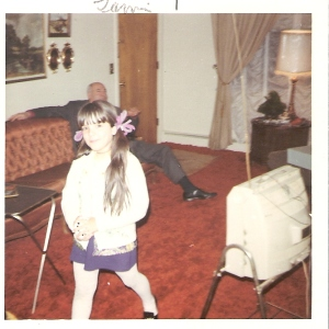 This is me when I was around 7 years old. Behind the pigtails and tights, there was trauma.